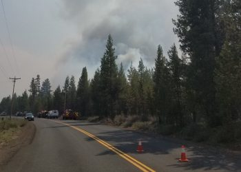 Brush fire destroys home, forces evacuations north of La Pine, Ore.