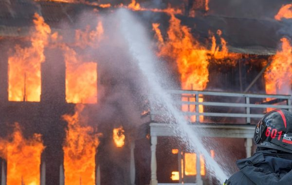 Firefighters working to put out burning SE Portland home